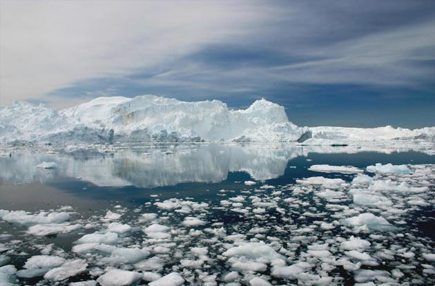 The Ilulissat Icefjord is a fjord, or narrow waterway, lined by steep cliffs, on the west coast of Greenland. The fjord was formed from the Jakobshavn Isbrae glacier, one of the most active glaciers in the world, calving (or breaking down) the ice sheets very frequently.