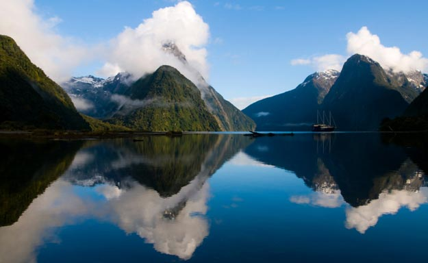 Milford Sound is a fjord carved out by a glacier, which created a narrow inlet, lined by steep cliffs and waterfalls.