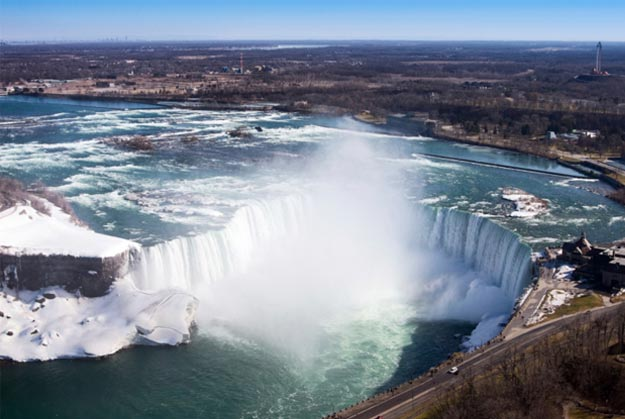 Niagara Falls is a group of three waterfalls along the border between the United States and Canada in New York and Ontario.