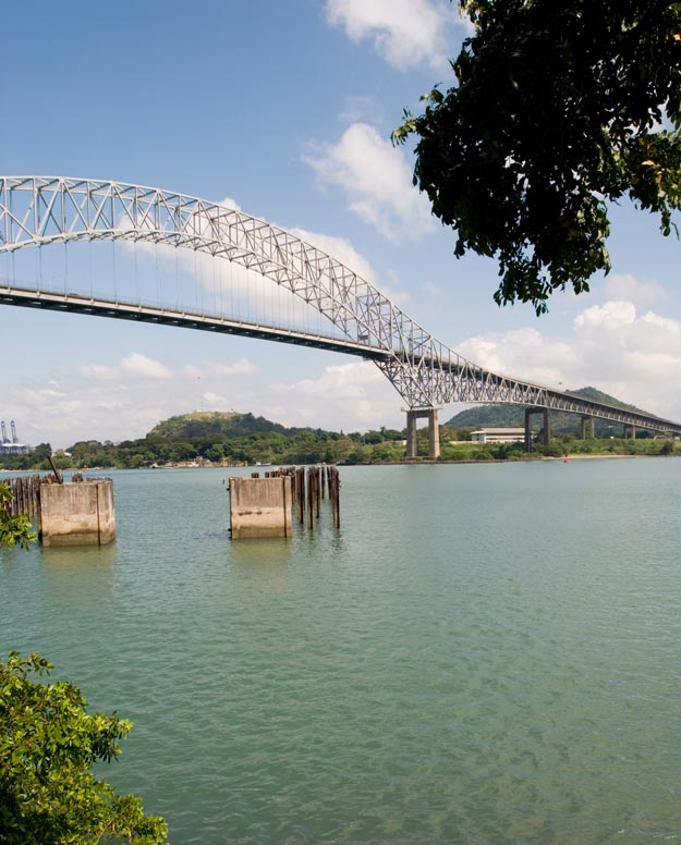 The Isthmus of Panama connects the Atlantic and Pacific Oceans, and the Panama Canal allows ships to pass through and access the West Coast of the United States.