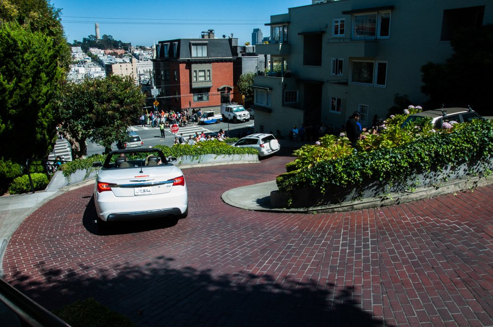 Coit Tower on the hill across from Lombard Street