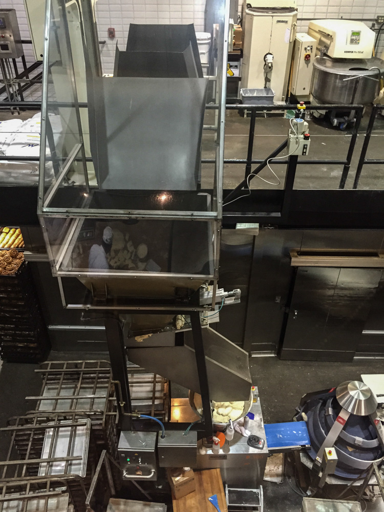 The dough goes through several machines, coming out as rounds