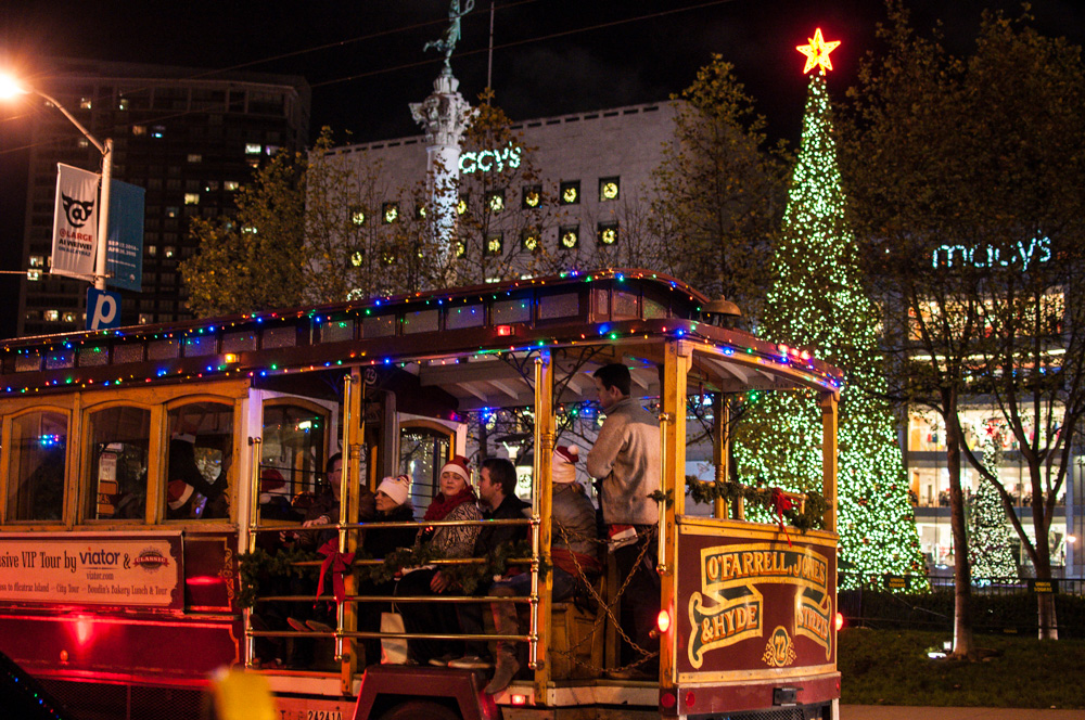 A decorated Cable Car passes Union Square