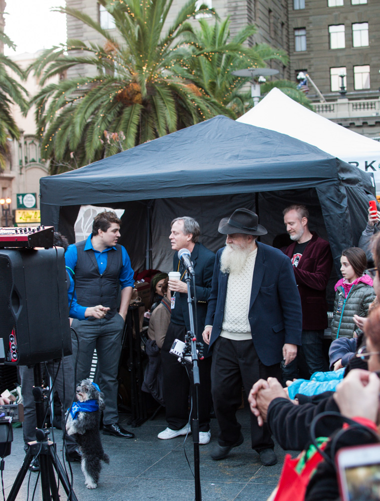 Rabbi Langer, Chris Barron, and the Olate family and dogs in the tiny performance space