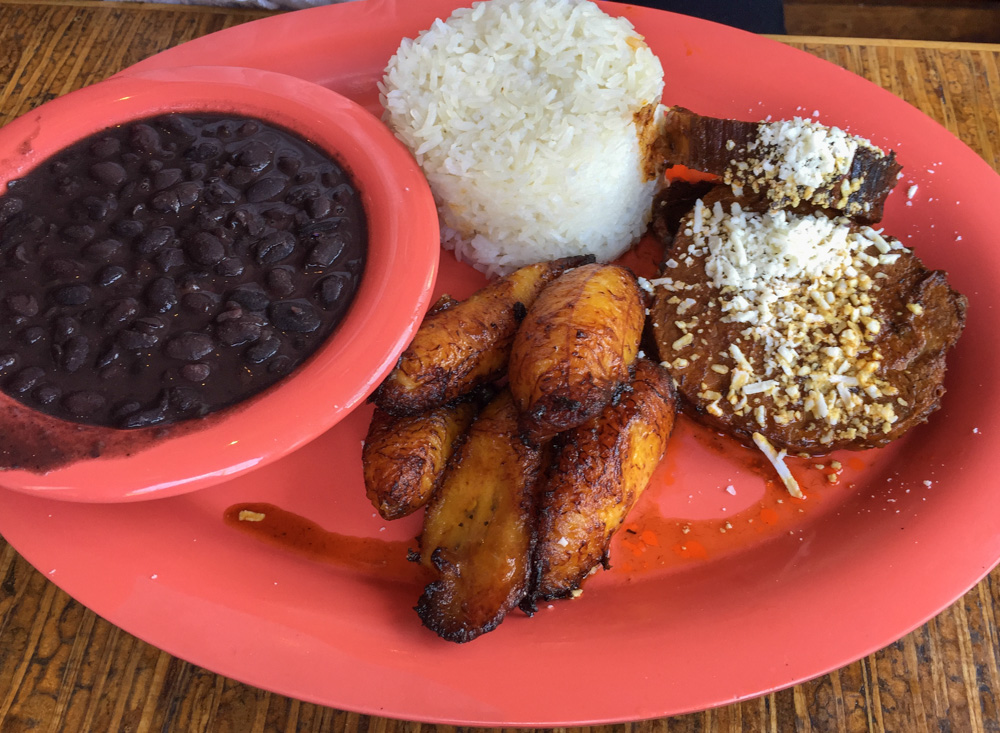 The beef asado plate with rice, beans, and sweet plantains