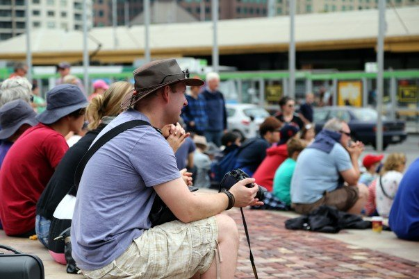 Crowd busy watching a show at Federation square