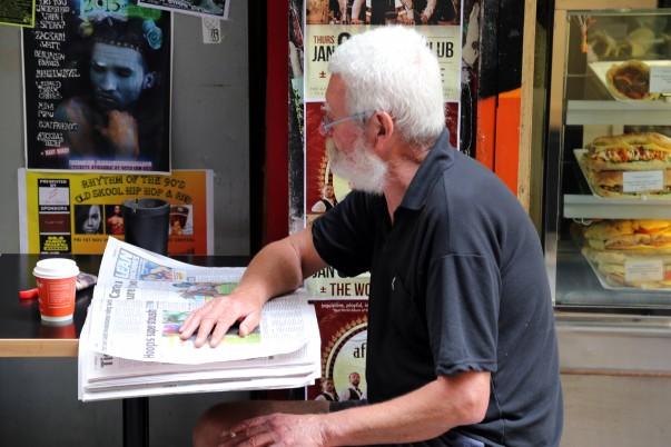 Serious reading at Centre place roadside café