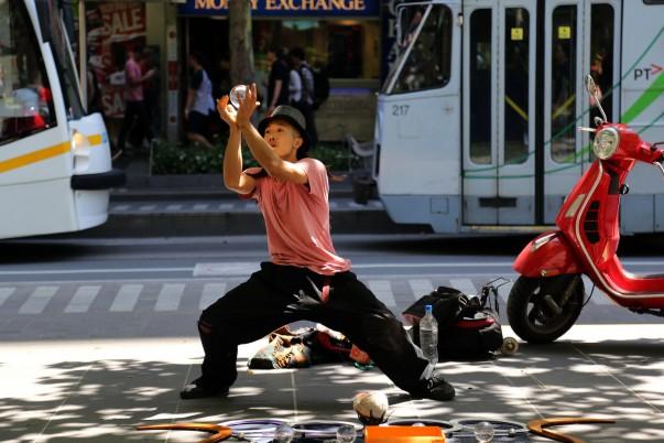 Glass Ball balance act at Swanston street