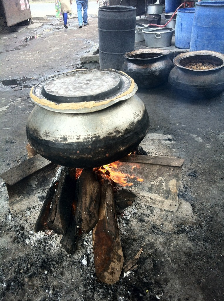 Biryani being cooked in an aluminium pot