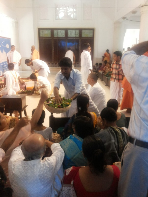 Pushpanjali(offering of flowers) at the Durga Puja.