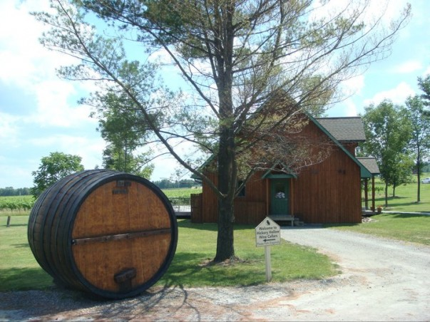 A beautiful winery with a barrel out front