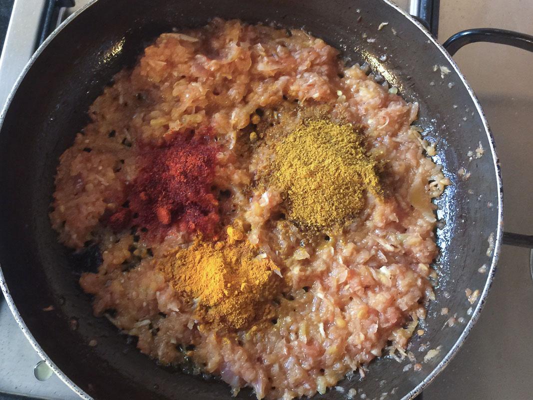 Adding spices to Burmese Shrimp Curry