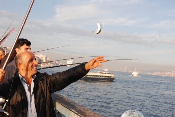 Fisherman catching the fish at Galata Bridge, Istanbul