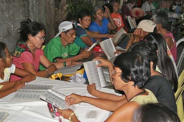 Devotees reading the chronicle of Jesus Christ