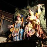 Durga's children karthik and Saraswati, accompant their mother to the Ganges