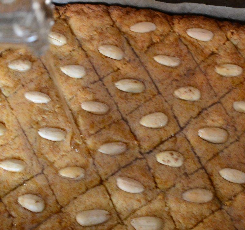 Pouring Sugar Syrup Over Baked Basbousa