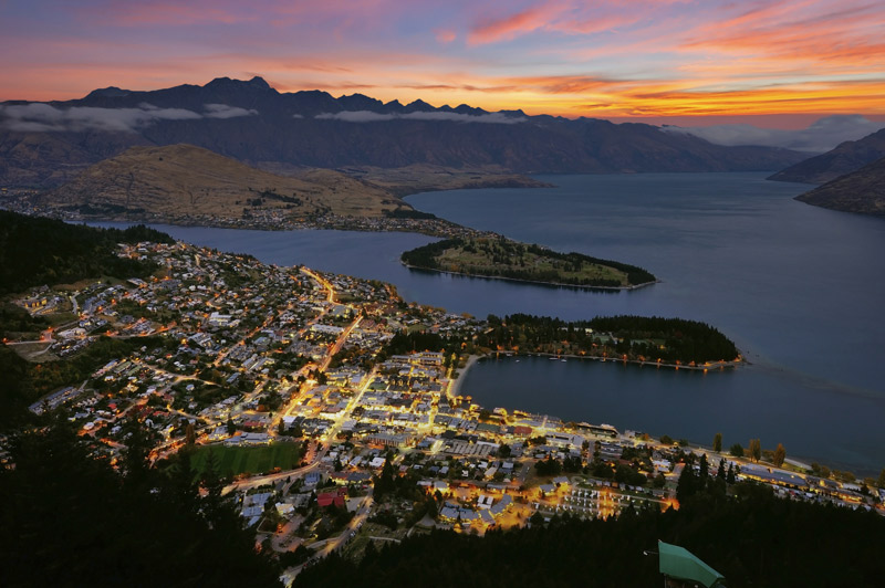 Tourists prefer to take a hot balloon ride over Queenstown at dawn