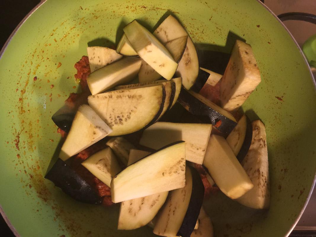 Adding egg plant for Terung Masak Lemak