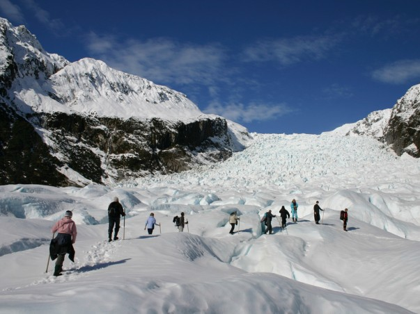 Tourist Walking over Fox Glacier