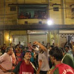 Frenzied devotees dance and play the drum